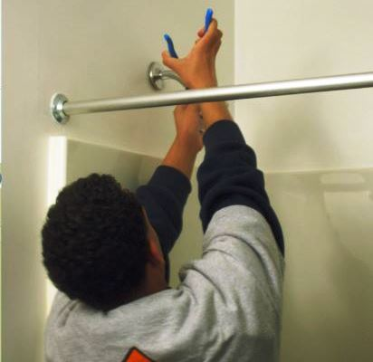 Student Fixing Showerhead