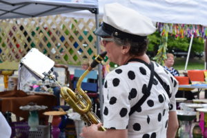 Emily Lisker of the Marching Milkman Band performing at the first market